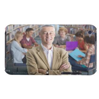 Smiling teacher standing in school library with iPod touch Case-Mate case