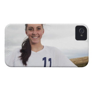 smiling teen girl soccer player w/ soccer ball iPhone 4 covers