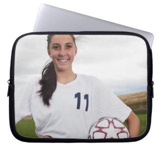 smiling teen girl soccer player w/ soccer ball laptop sleeve