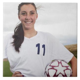 smiling teen girl soccer player w/ soccer ball large square tile