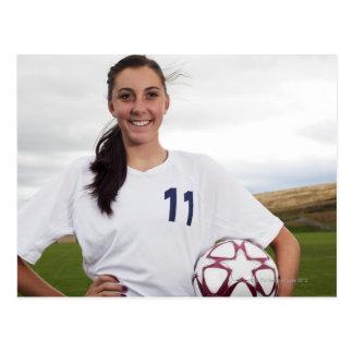 smiling teen girl soccer player w/ soccer ball postcard