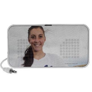 smiling teen girl soccer player w/ soccer ball travel speaker