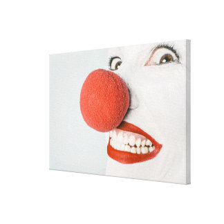 Smiling woman clown with a big red nose, stretched canvas prints