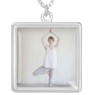 Smiling woman doing yoga silver plated necklace