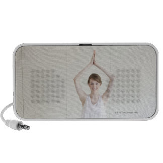 Smiling woman doing yoga travelling speakers