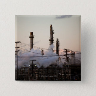 Smoke stacks and distillation towers rise 15 cm square badge