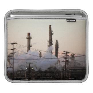 Smoke stacks and distillation towers rise iPad sleeves
