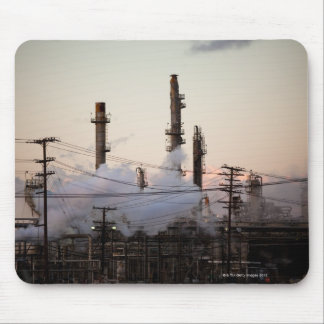 Smoke stacks and distillation towers rise mouse pad