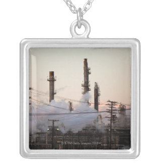 Smoke stacks and distillation towers rise necklace