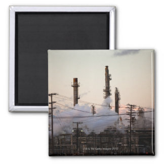 Smoke stacks and distillation towers rise square magnet