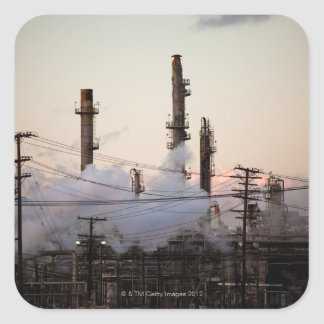 Smoke stacks and distillation towers rise sticker