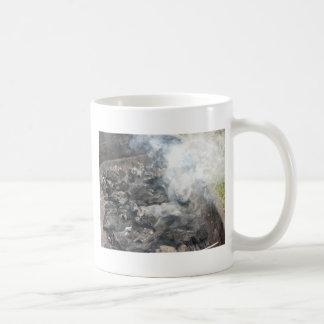 Smoking burning charcoal on barbecue coffee mug