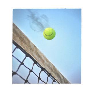 Smoking Tennis Ball Flying Over Net Notepad