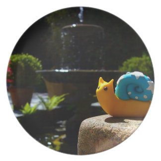 Snail visits fountain in English Garden Plate