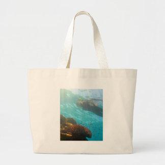 Snorkeling over an underwater reef tote bag