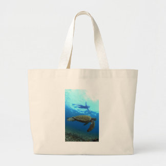 Snorkeling with sea turtle Galapagos Islands Canvas Bags