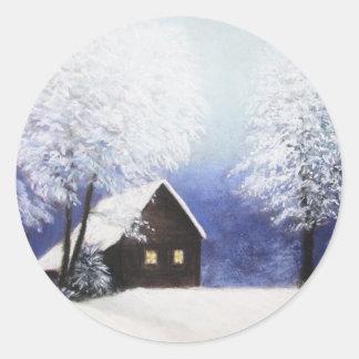 snow cabin winter landscape in pastel round sticker