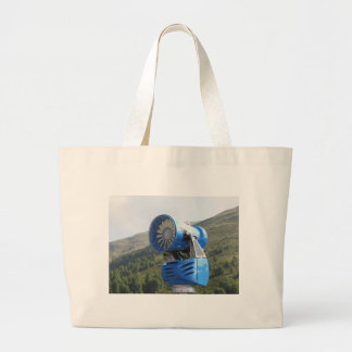 Snow cannon with mountains background jumbo tote bag