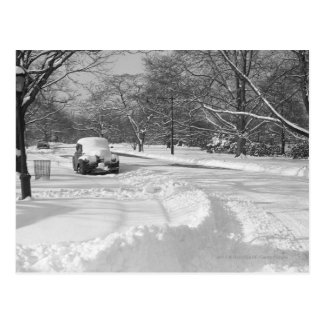 Snow capped car on street B&W Postcard