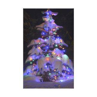 Snow Covered Brightly Lit Christmas Tree Stretched Canvas Print
