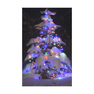 Snow Covered Brightly Lit Christmas Tree Gallery Wrap Canvas