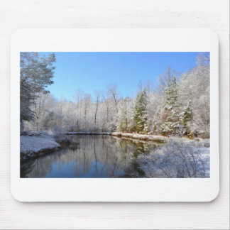 Snow covered landscape around the pond mouse pad