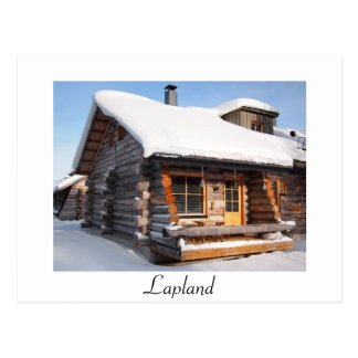 Snow-covered log cabin in Lapland white postcard