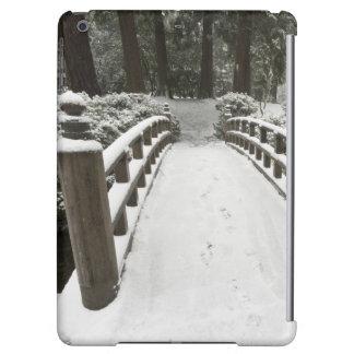 Snow-covered moon bridge, Japanese Garden