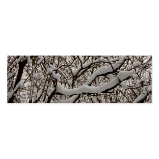 Snow covered tree branches business card