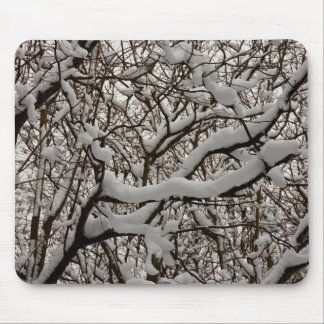 Snow covered tree branches mouse pads