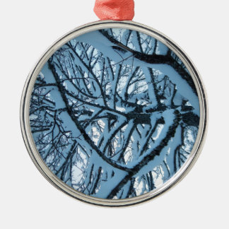 Snow covered tree christmas ornament