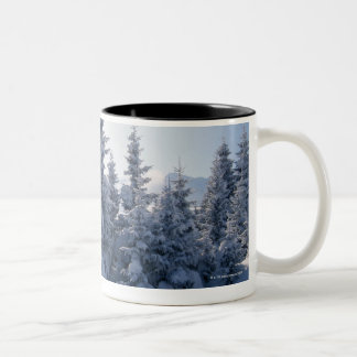 Snow-covered trees and mountains Two-Tone coffee mug