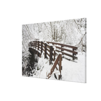 Snow Covered Wooden Bridge Canvas Print