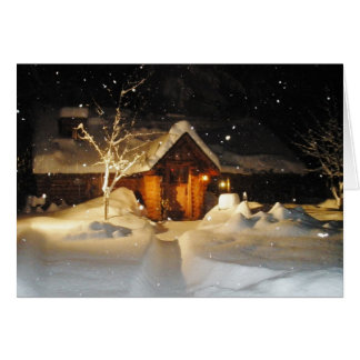 Snow Falling on Log House at Night Christmas Card