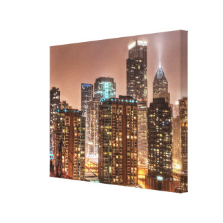 Snow falls over skyline at evening in Chicago Canvas Print