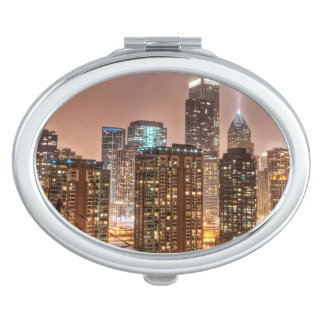 Snow falls over skyline at evening in Chicago Compact Mirror