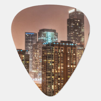 Snow falls over skyline at evening in Chicago Guitar Pick