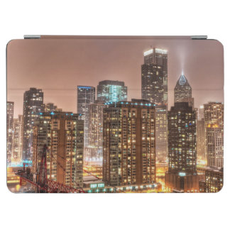 Snow falls over skyline at evening in Chicago iPad Air Cover