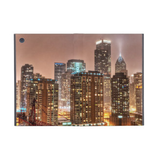 Snow falls over skyline at evening in Chicago iPad Mini Cases