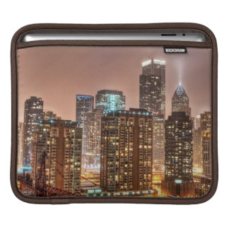 Snow falls over skyline at evening in Chicago iPad Sleeve