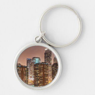 Snow falls over skyline at evening in Chicago Key Ring