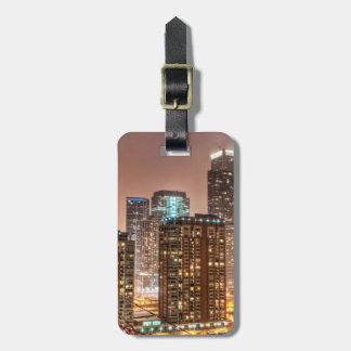 Snow falls over skyline at evening in Chicago Luggage Tag