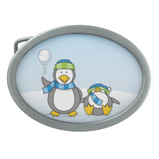 Snowballing penguins oval belt buckles