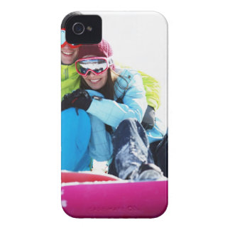 Snowboarder couple sitting on snow iPhone 4 Case-Mate case