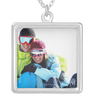 Snowboarder couple sitting on snow silver plated necklace