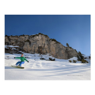 Snowboarder free riding postcard