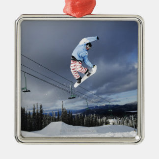 Snowboarder jumping in mid-air doing a backside Silver-Colored square decoration