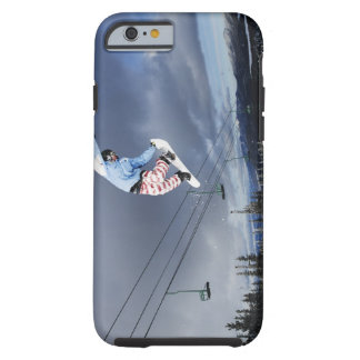Snowboarder jumping in mid-air doing a backside tough iPhone 6 case