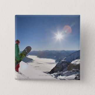 Snowboarder looking from mountain top 15 cm square badge
