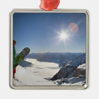 Snowboarder looking from mountain top christmas ornament